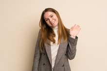 Young Business Woman Saluting With Hand With Happy Expression