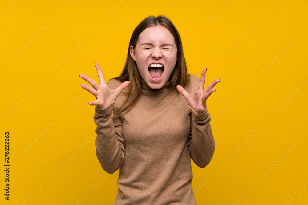 Fototapety, obrazy: Young woman over colorful background unhappy and frustrated with something