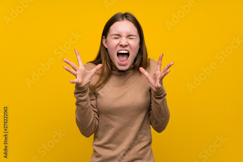 Young woman over colorful background unhappy and frustrated with something Tapéta, Fotótapéta