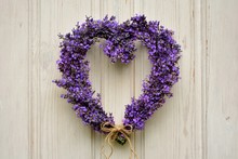 Lavender Heart Wreath On White Wooden Door Close-up