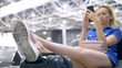 travel concept, air travel. woman sitting at the airport. She put her feet on a suitcase nearby and uses her smartphone.