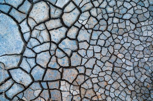 Fototapeta  Brown dry cracked ground texture background
