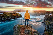Man Standing By Amazing Godafoss Waterfall In Iceland During Sunset, Europe