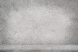 Fototapeta Kamienie - Concrete floor with empty grey concrete wall background.
