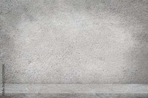 Concrete floor with empty grey concrete wall background. - 278286686
