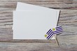 happy Uruguay independence day. August 25. the concept of freedom, independence and patriotism. mini flags with sheets of white paper on wooden background. horizontal