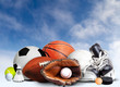 Sports Equipment For All Seasons With Sky Clouds Background