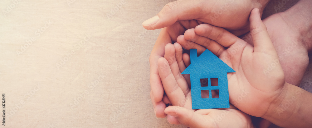 Fototapety, obrazy: Adult and child hands holding paper house, family home and real estate concept