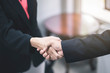Business people shaking hands at the office. Success teamwork, partnership and handshake business concept