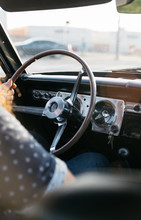 Interior Of Classic Car With Man Driving Hand On Steering Wheel