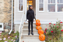 Teen Girl Dressed As A Black Cat, Leaving Her House To Go Trick Or Treating