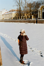 Young Woman Standing On Frozen Canal