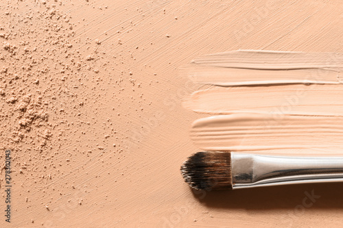 Leinwand Poster Makeup foundation background with beige liquid foundation, concealer smudges, fa