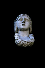 Fragment Of Ancient Statue Of The Goddess Of Wisdom And Victory Athena Isolated On Black Background.