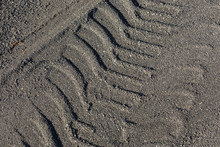 Tire Tracks Over Gravel