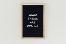 "Good Things Are Coming"""" Written On A Letterboard Hanging On The Wall"