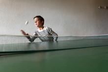 Boy Reaching To Catch A Bal At...
