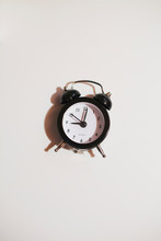 Miniature Clock On A White Background
