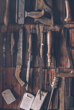 Different Kind Of Tools On Wooden Shingle Background