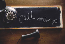 Vintage Candlestick Telephone With Personalized Note On Chalkboard