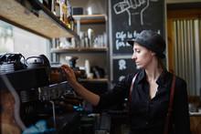 Young Female Barista Preparing A Espresso Coffee