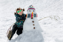 Little Girl With A Snowman