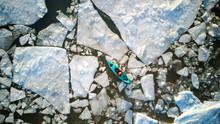 Aerial View Of Kayaker Surroun...