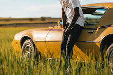 Black African Man Besides A Classic Car Waiting For Assitance