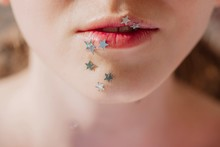 Crop Photo Of Lips With Silver...
