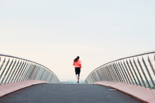 Athlete Jogging On Bridge