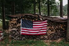 USA Flag On A Woodpile