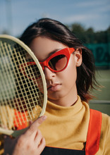 Stylish Asian Female With Tennis Racket