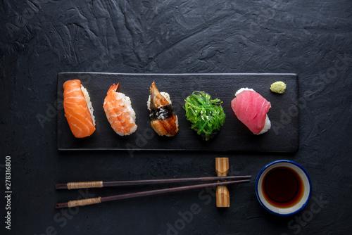 Recess Fitting Sushi bar Set of sushi on dark stone table. Top