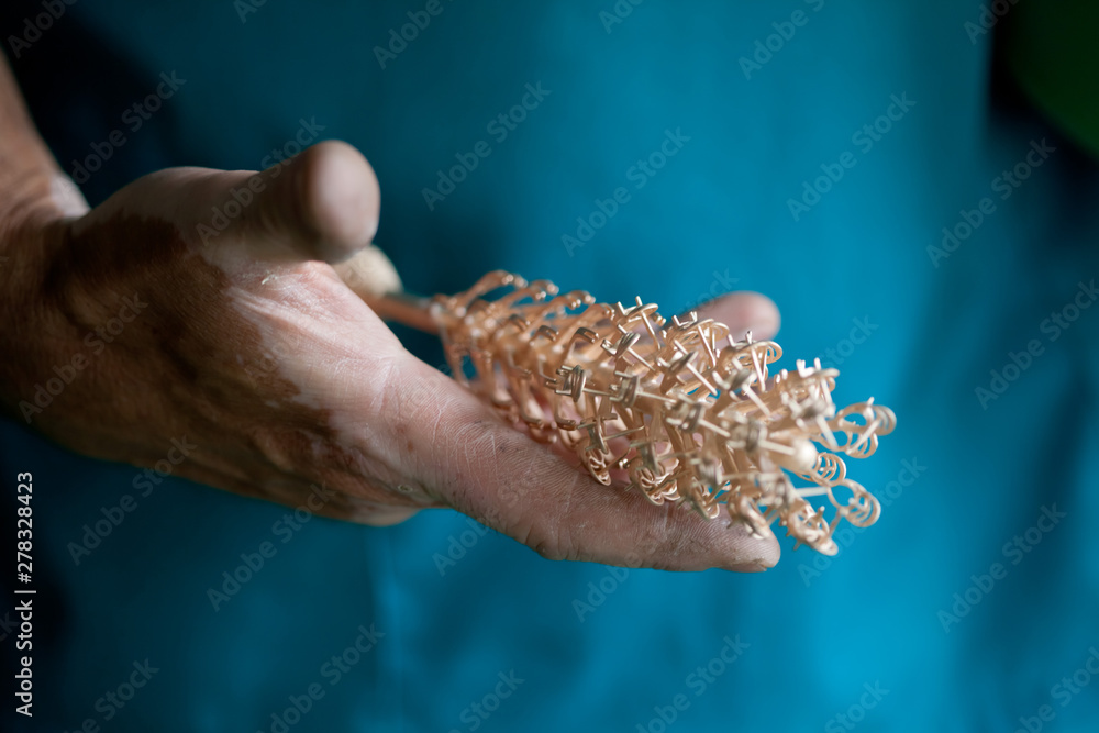 Fototapety, obrazy: hands holding cast golden parts for jewelry