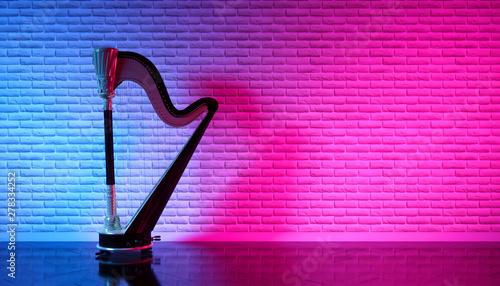 Vászonkép old harp in mysterious neon lighting, 3d illustration