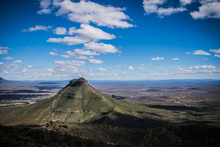 Mountain In The Valley Of Desolation In Matjiesfontein, Graaf-Reinet, South Africa - With Rich Blue Sky And White Clouds Shadowing The Valley.