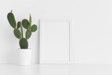 White Frame Mockup With A Opuntia Cactus In A Pot On A White Table. Portrait Orientation.