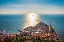 Aerial View Of The Old City Piran And Beautiful Sailing Ship With Five Masts At Sunset Time. Slovenia, Europe