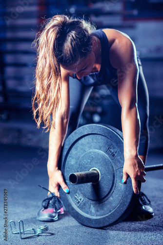 Fototapeta  Woman weightlifting on training