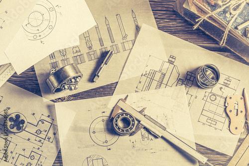 Fototapeta  Top view of milling cutters, bearings and mechanical diagrams