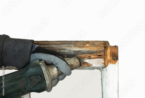 Person using a router while restoring and preserving sash windows