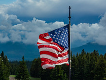 American Flag, Red, White And Blue, Stars And Stripes Flying In The Breeze