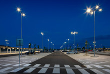 Big Modern Empty Parking Area With LED Street Lights At Night