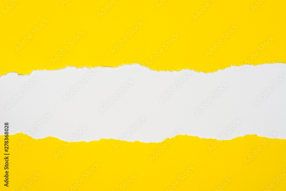 Fototapeta pieces of yellow paper on white background with copy space