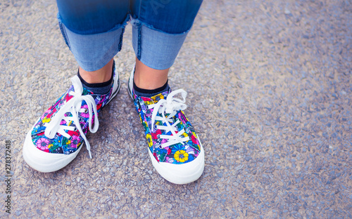 Original and stylish colourful woman shoes on the street - happy lifestyle Canvas Print