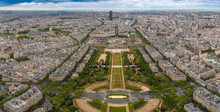 Perfect Aerial Panorama Of The Champ De Mars Park, The École Militaire Building Behind, The Les Invalides Building Complex With The Golden Dome And In The Distance The Skyscraper Tour Montparnasse.