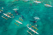 Tourists are watching whale sharks in the town of Oslob, Philippines, aerial view. Summer and travel vacation concept.