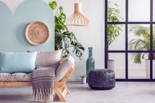 Wooden Furniture And Wicker Accents In Fashionable Blue, Green And White Interior