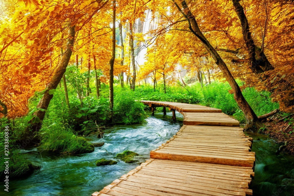 Fototapety, obrazy: Beautiful wooden path trail for nature trekking with lakes and waterfall landscape in Plitvice Lakes National Park, UNESCO natural world heritage and famous travel destination of Croatia.
