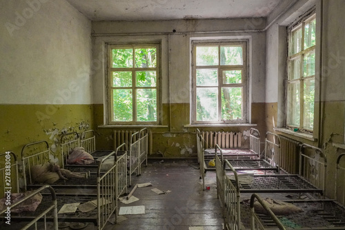 Crumbling ruins of a bedroom in a school in Pripyat, Ukraine near Chernobyl that Canvas Print
